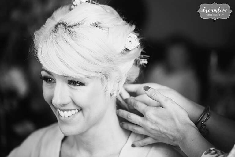 Documentary wedding photography of the bride having hair done at Bishop Farm.