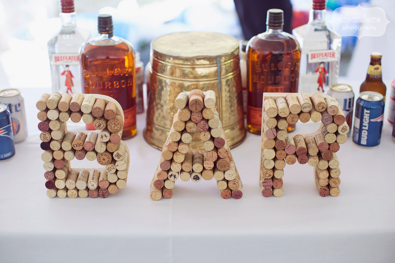 Unique weddind bar sign made of corks.