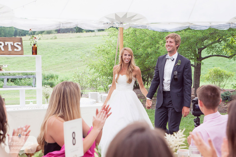 Bride and groom are introduced into the tented reception at the 1824 House in VT.