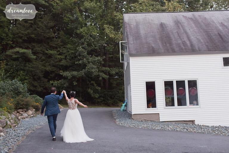 Silly bride and groom walk to dance floor in NH.