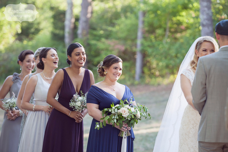 Bridemaids laughing during the outdoor ceremony at the Overbrook House on Cape Cod, MA.