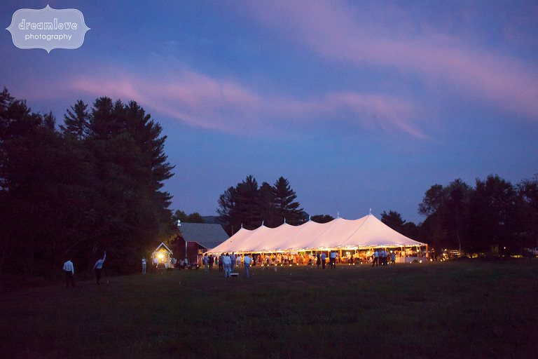 Magical wedding photo of the reception tent lit up at night under the stars at the 1824 House in VT.