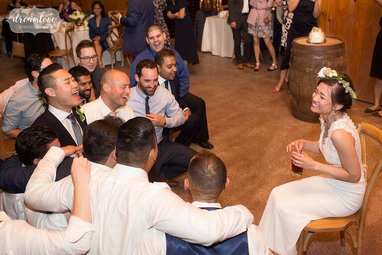 Funny photo of groomsmen singing to bride at Hudson Valley barn wedding.
