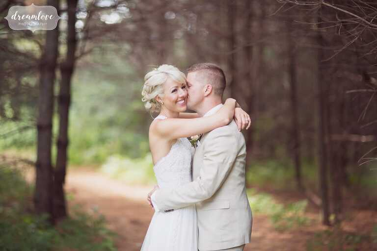 Woodland wedding venue at Bishop Farm in NH with bride and groom in pine forest.