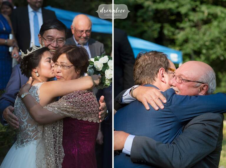 Parents hug the bride and groom after their small ceremony.