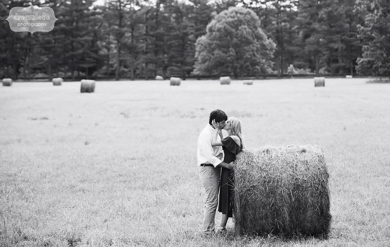 Fine art engagement photography with hay bales and the couple in Hyde Park, NY.