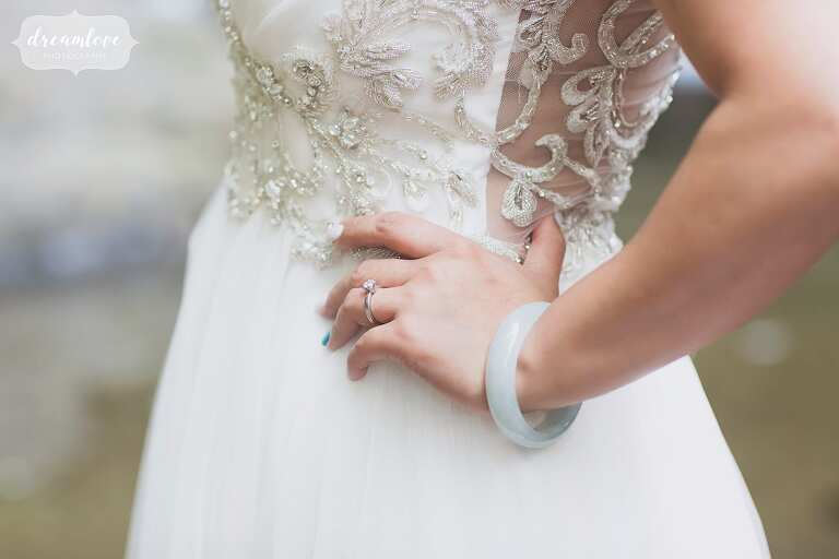Fine art wedding photographer with bride in lace dress and teal bracelet.