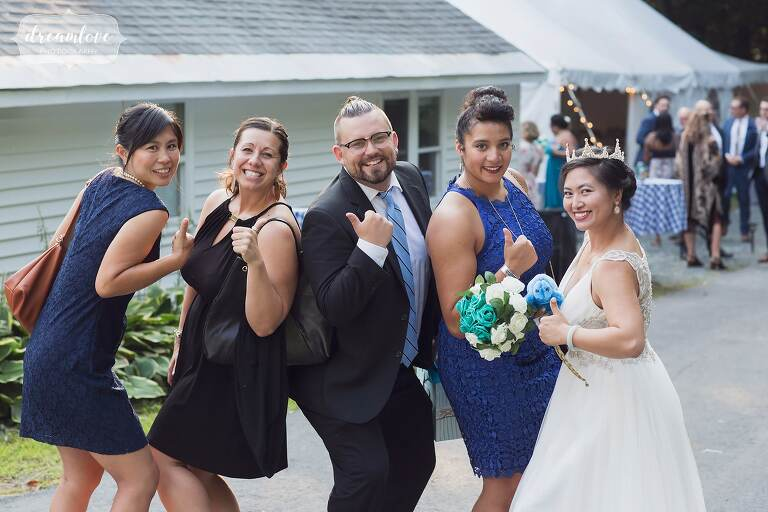 Wedding guests pose for funny photo.