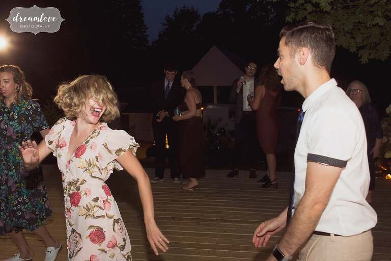 Funny dance moves in outdoor pavilion.