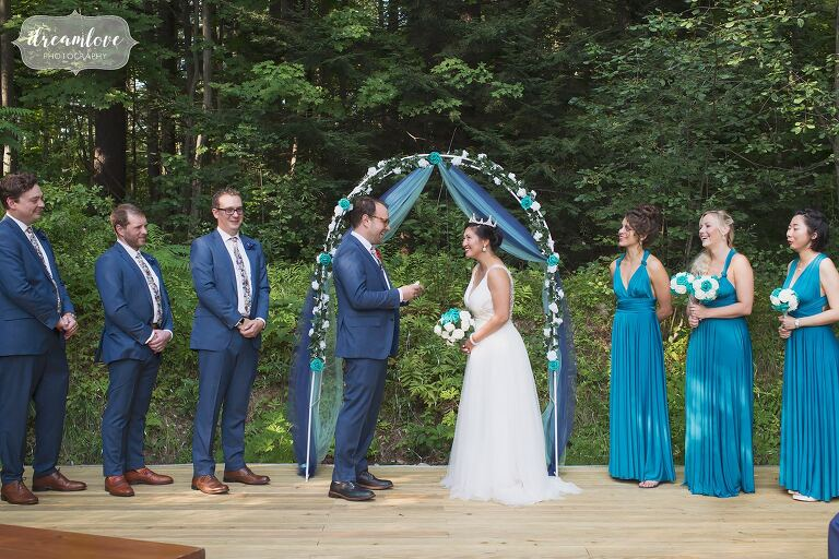 Groom reads his vows to bride in an intimate ceremony.