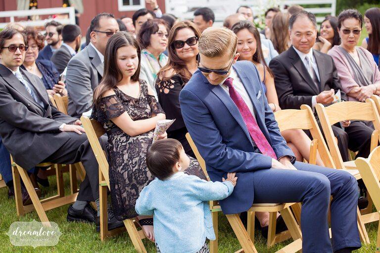 Funny kid at wedding at Barn at Liberty Farms.