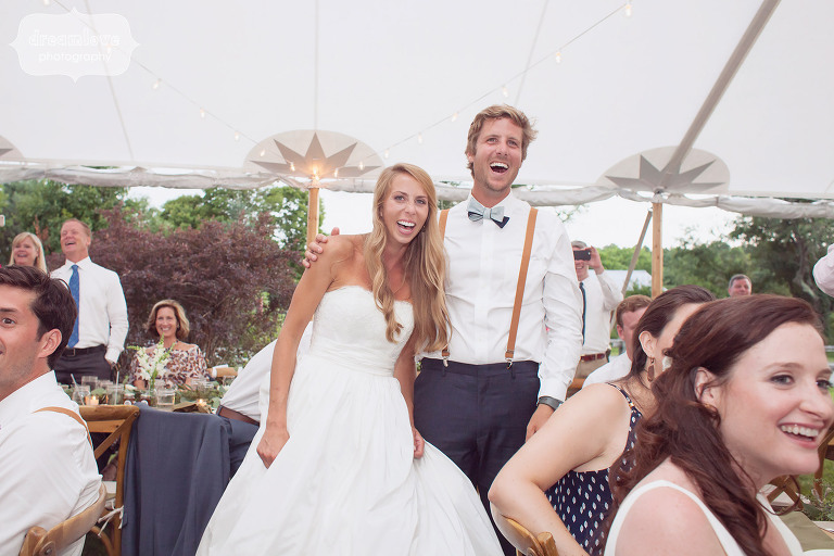Candid photo of the bride and groom laughing during their reception at the 1824 House in VT.