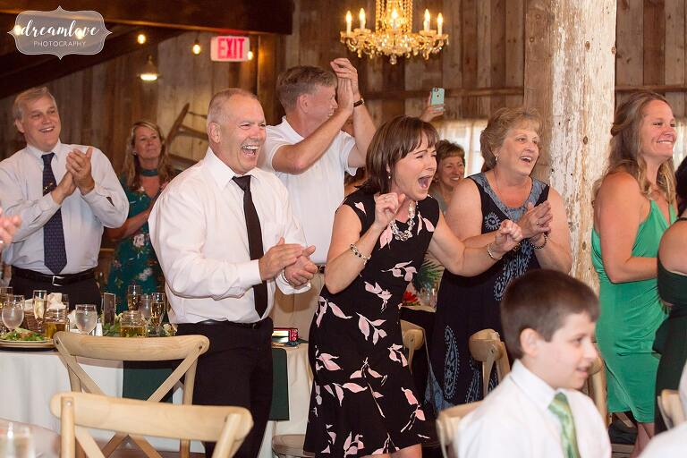 Guests react while kids perform a dance at Bishop Farm wedding.