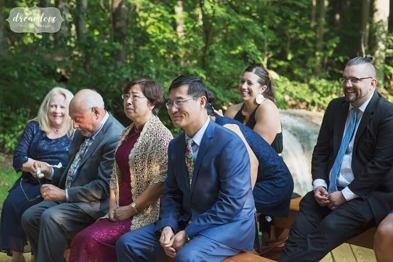 Bride's father watches backyard wedding ceremony.