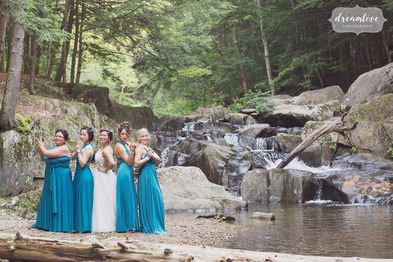 The bridesmaids do a Charlie's Angels pose by the creek in Hanover, NH.