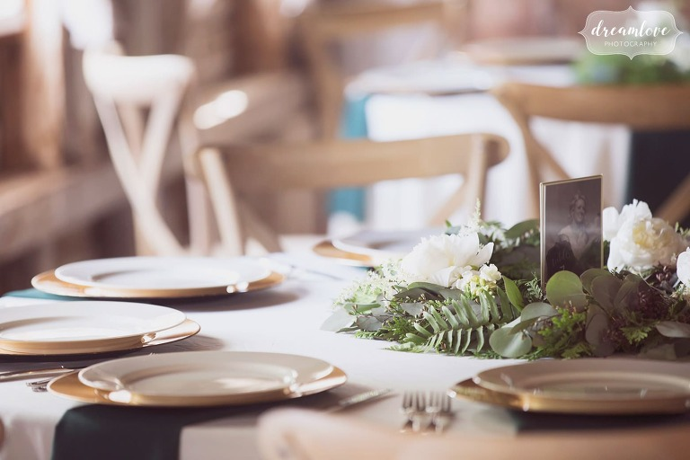 Simple table decor of ferns for this woodland wedding at the Bishop Farm barn in NH.