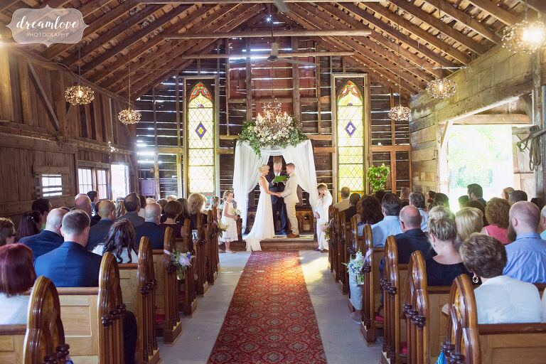 A view of the indoor barn ceremony space at the Bishop Farm wedding venue in NH.