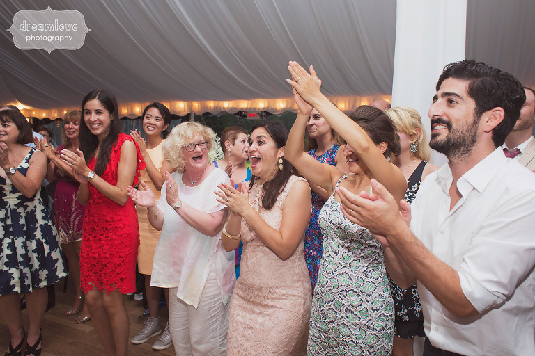 Documentary photos of wedding guests on the dance floor in Stowe, VT.