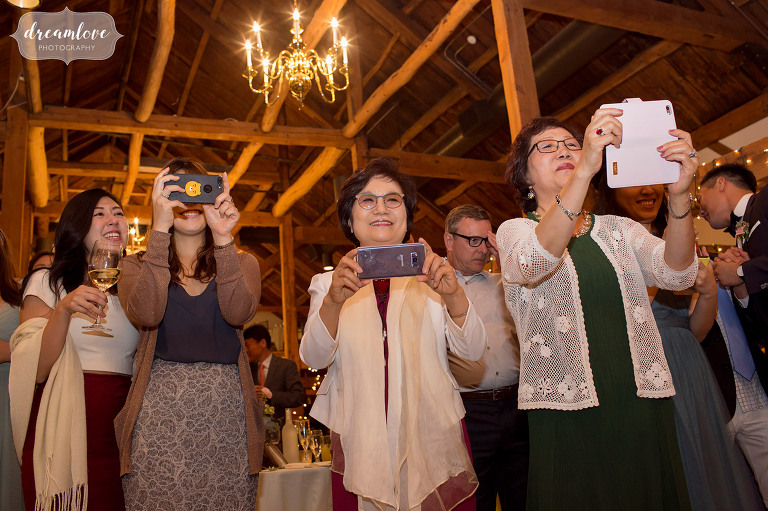 Funny wedding photos of all of the Korean guests taking photos with their cell phones during the father daughter dance at the Inn on Main in NH.