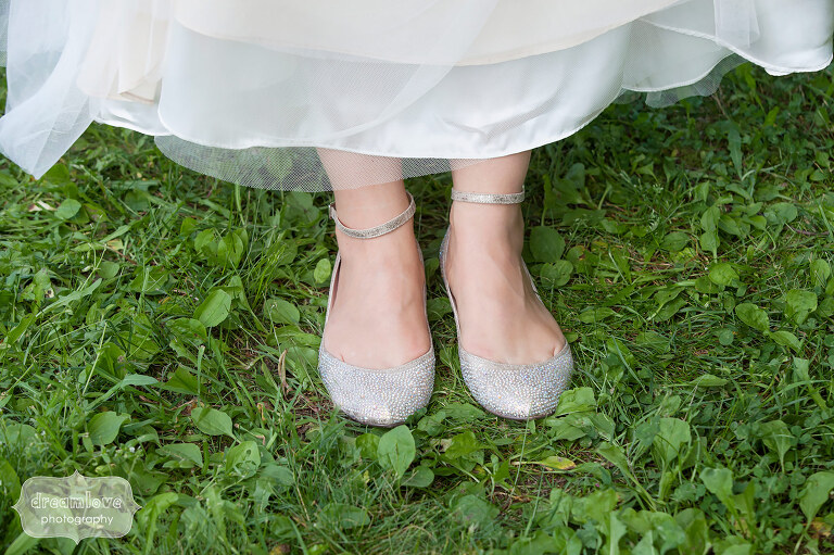 The bride shows off her sparkly flat shoes for the wedding at Sugarbush in VT.
