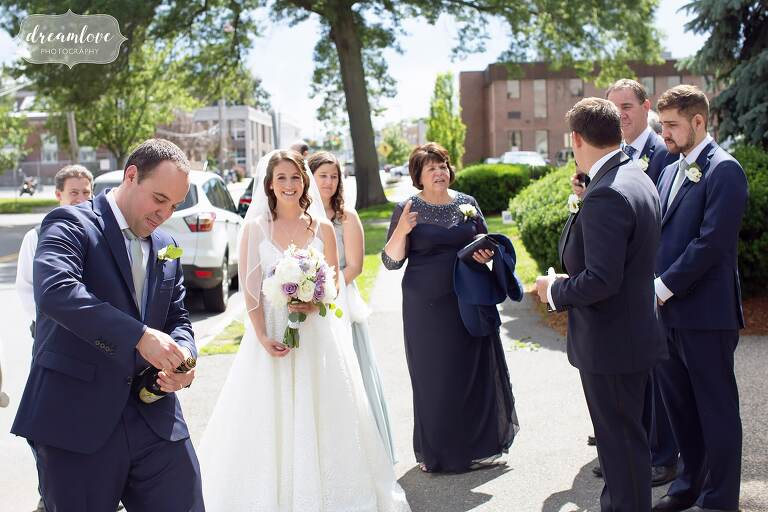 Wedding popping champagne outside of St. Mary's Church in Danvers, MA.