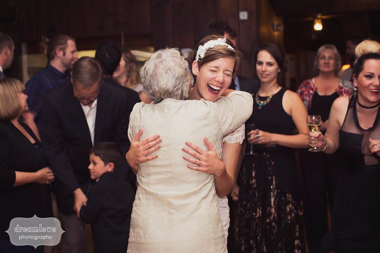 Documentary wedding photo of bride hugging grandma at Berkshires wedding in MA.