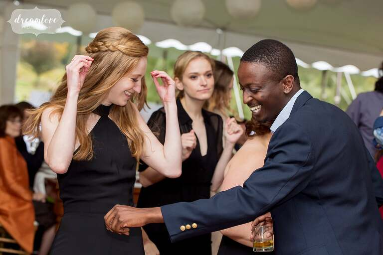 The guests dance under a tent at this Catskills wedding.