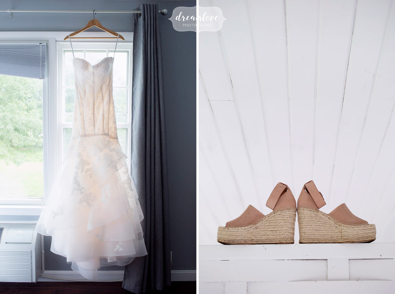 The bride's dress hangs at the Inn on Main in Wolfeboro, NH before her lakes wedding.