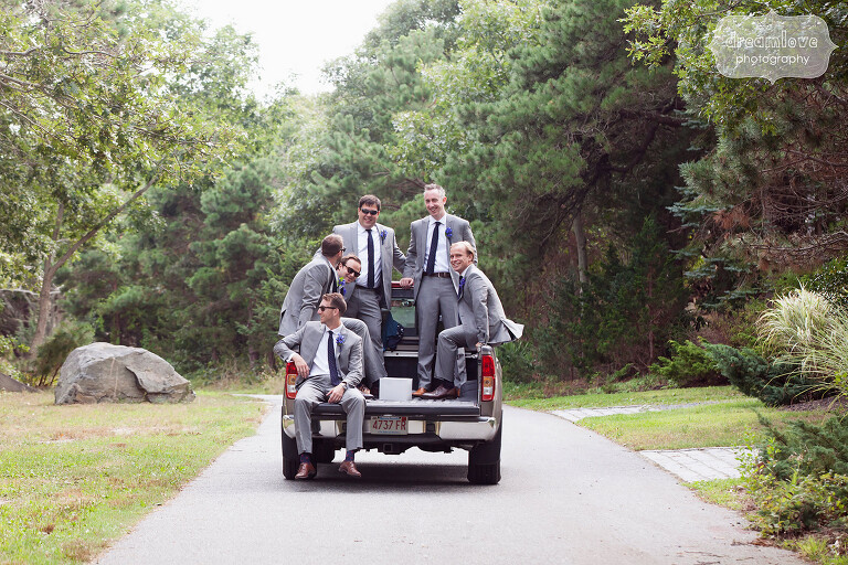 Funny photo of the groomsmen in the back of a pickup truck on Cape Cod.