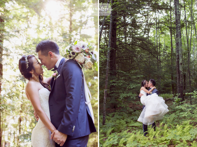 The groom carries his bride through the ferns in the forest after their outdoor wedding in Wolfeboro, NH.