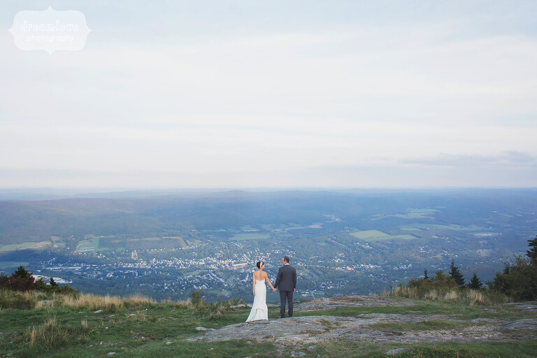 Bride and groom stand on the mountaintop of Mt. Greylock for their Berkshires wedding in western MA.
