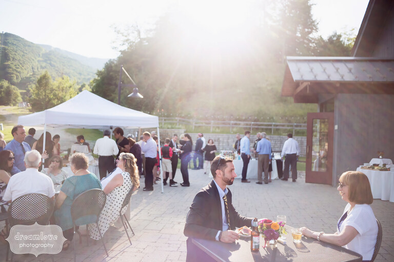 View of the outdoor cocktail hour at the Sugarbush Resort, VT for a June wedding.