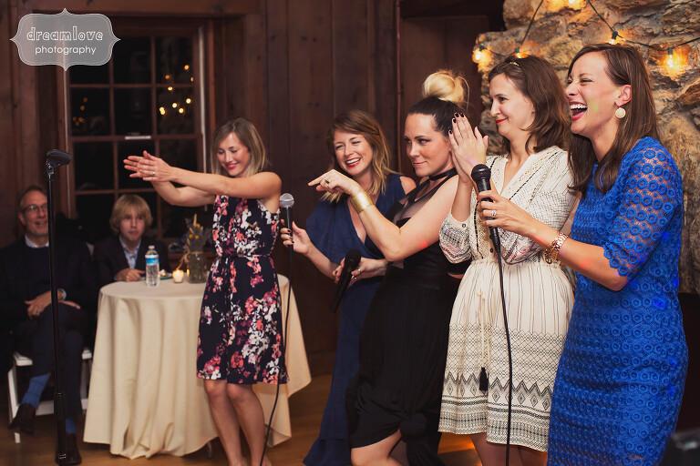 Funny girls doing karaoke at wedding reception in Western MA at Bascom Lodge.
