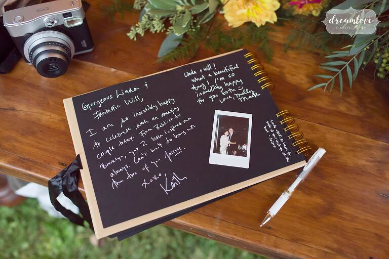 Chalkboard style guest book at this Catskills backyard wedding.