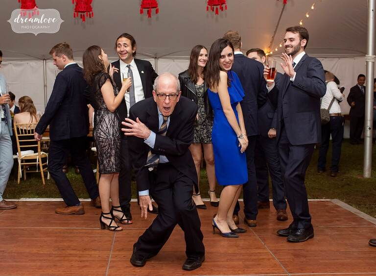 Hilarious old man dancing in front of young people for this Catskills backyard wedding.