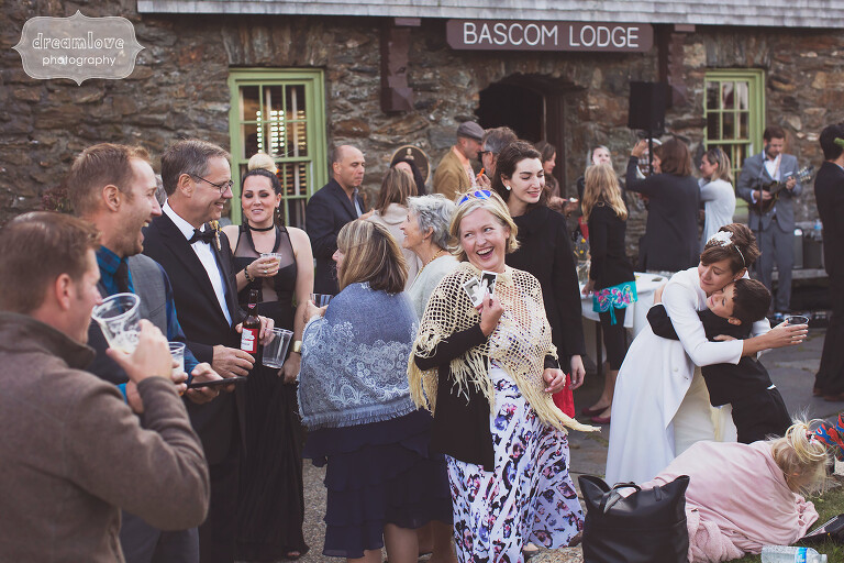 Guests mingle during the outdoor cocktail hour at the Bascom Lodge in Western MA.