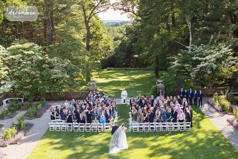 Bride enters the garden ceremony at this south shore wedding estate venue.