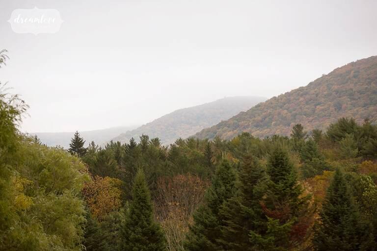 Fall foliage over the hills at this Catskills backyard wedding in Roxbury, NY.
