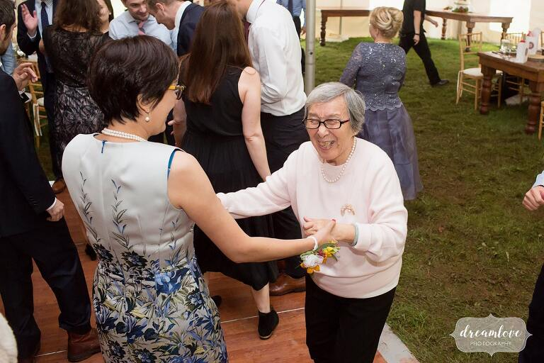The grandma dances with her daughter at this Catskills wedding.