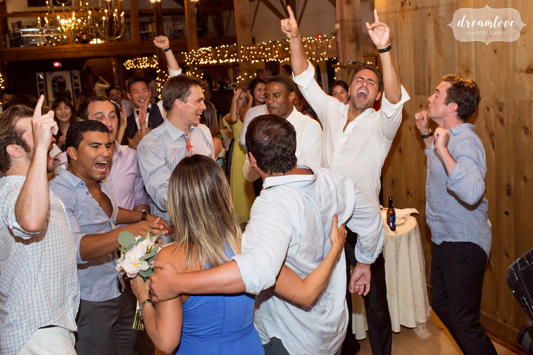 Wild wedding guests carry someone's boyfriend to the dance floor after catching the bouquet in Wolfeboro.