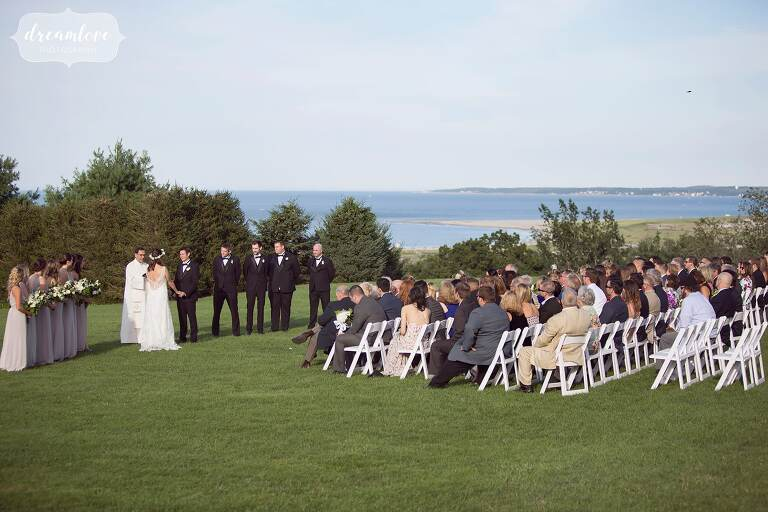 Wedding ceremony with an ocean view at the Crane Estate in MA.