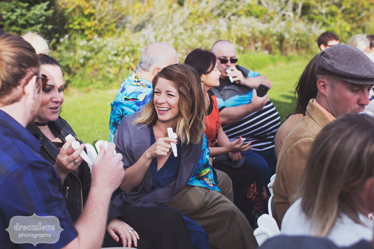 Guests play kazoos at Mt. Greylock wedding ceremony in MA.