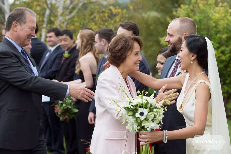 The bride greets guests in receiving line in Roxbury.
