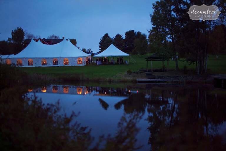 Twilight magic blue light over the tent at this Catskills backyard wedding.
