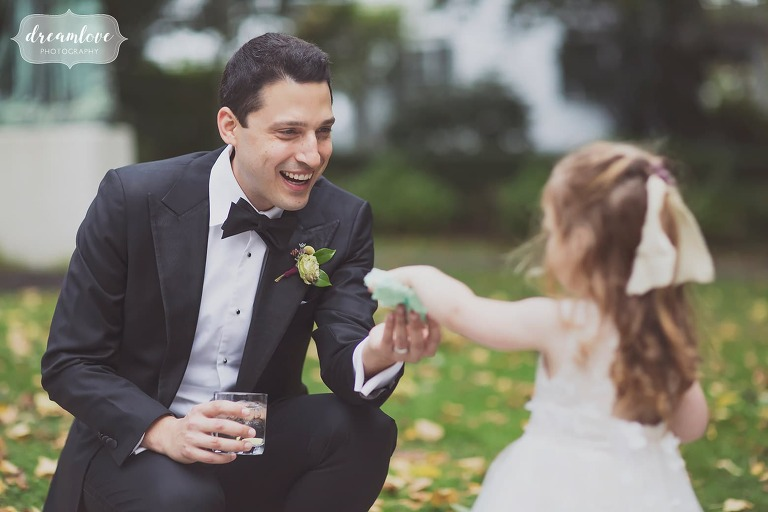 The groom talks with the flower girl at the Linden Place Mansion.