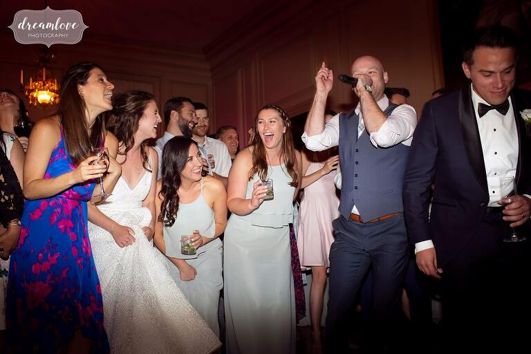 Bearfight sings with audience at Crane Estate wedding.