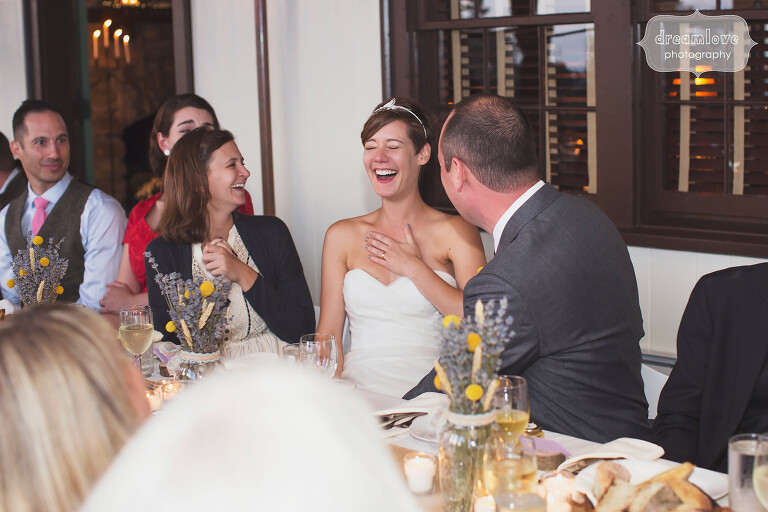 Bride laughing during speeches at this rustic Berkshires wedding venue in MA.