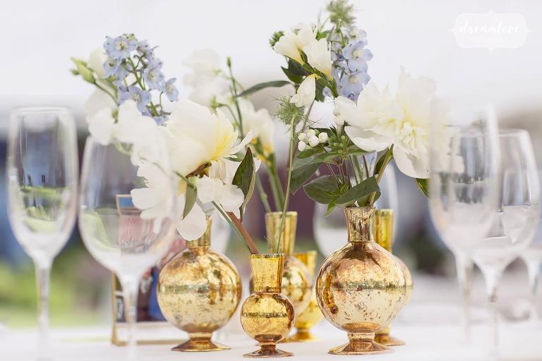 Gold flower vases wedding table decor.