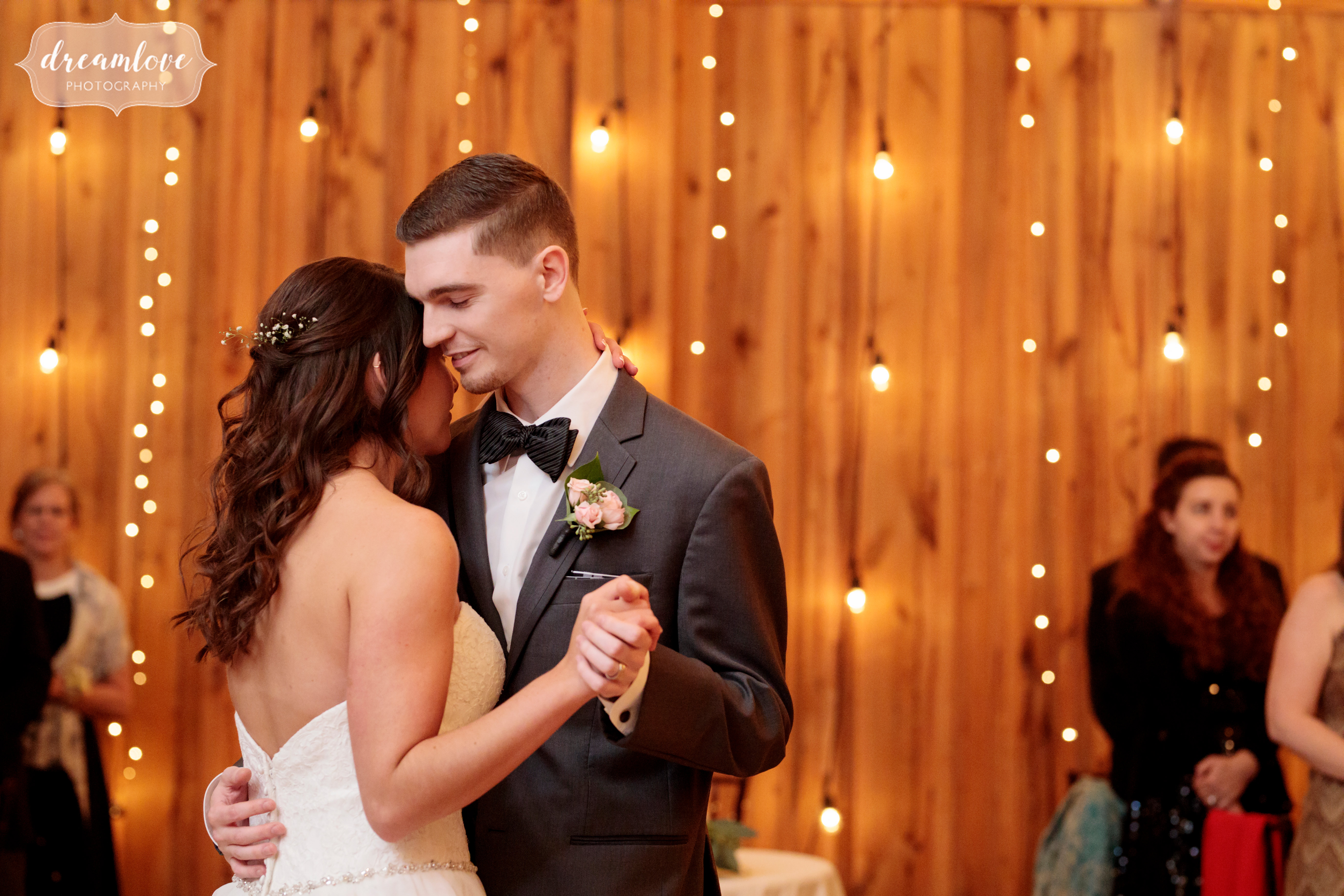 The bride and groom have a romantic first dance in CT.