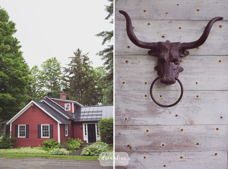 Red farmhouse on the property at the Stowe Comfort Farm barn, a rustic wedding venue.